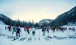 Skiers and snowboarders scramble to their gear at the start of the 2015 Arapahoe Basin Enduro. The annual race returns this year as a fundraiser for David Repsher, the local Flight for Life paramedic who was injured in a helicopter crash in Frisco last July.