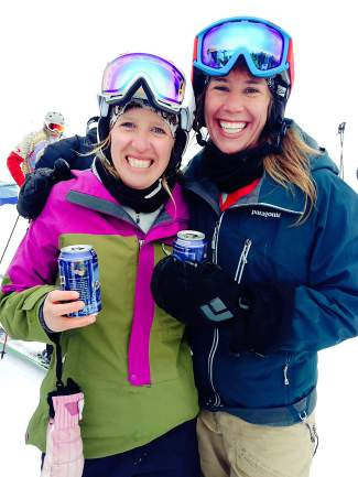Summit County locals Whitney Henceroth (left) and Linsey Hempel at the top of Pallavicini Chair high above Arapahoe Basin after finishing 64 laps in 10 hours in 2015. It was Hempel's first attempt at the record for a women's team and the two came up short by one.