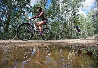 Racers ascend up a series of aspen-lined switchbacks during the Fall Classic mountain bike race in Breckenridge in September. One full ski season later, MTB guru Mike Zobbe is back and reminding folks to ride through the puddles, not around.