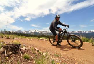 Breckenridge mayor Eric Mamula whips through a berm in a meadow high above Carter Park on the Barney Ford trail during a lunch loop ride for Breck Bike Week in June.