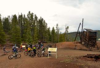 A group of cyclists gathers at Sallie Barber mine outside of Breckenridge halfway through a lunch loop ride led by Breckenridge mayor Eric Mamula for Breck Bike Week in June.