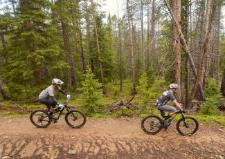 Breckenridge mountain biker Matt Powers (right) and former Boulder pro Paul Wells pedal along a stretch of wooded doubletrack on Weber Gulch trail during a lunch loop led by new Breck mayor Eric Mamula — Powers' brother-in-law and Wells' friend of 25-plus years.