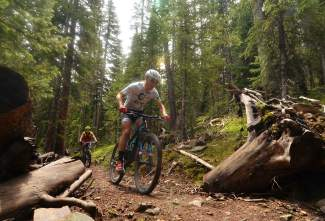Local XTERRA athlete Jaime Brede barrels through the first section on Trail of Tears in Breckenridge during a lunch loop ride with Eric Mamula, the new town mayor, during Breck Bike Week in June.