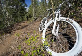 A stark-white tribute to Glen Peoples, a Dillon resident who died of an apparent heart attack at the Gold Run Rush in 2015. The bike now sits on the side of the Minnie Mine trail of the French Gulch system.