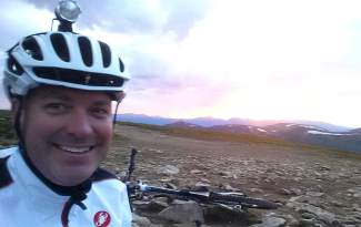 Adam Shaw high on the Continental Divide at sunset. The Mountain's Revenge event takes riders on a 24-hour tour of trails in the Montezuma area, including Webster Pass and other routes on the Divide.
