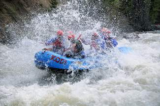 Guests with KODI Rafting punch through  a section of rapids on the Upper Blue in May 2014. This season, new owners Amy and Dave McGrath take over for longtime owners Campy and Christy Campton.