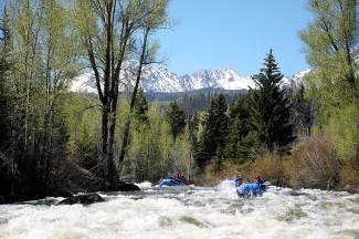Rafters charge down a section of rapids on the Upper Blue River with Frisco-based KODI Rafting in May 2014. In November, longtime owners Campy and Christy Campton sold the business, which has five locations spread across the state, to former Summit County residents Amy and Dave McGrath.