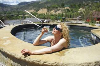 Host Shawna Henderson relaxes in a mineral hot pool at Iron Mountain Hot Springs in Glenwood Springs. The relatively new destination has 16 all-natural mineral pools of varying sizes.
