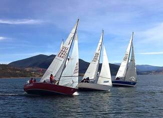 A trio of sailboats forms a line on Lake Dillon during training for upcoming regatta races like the Dillon Open from Aug. 5-7.