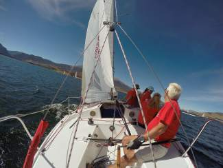 A taste of high-siding on a J22 sailboat while sailing on Lake Dillon, one of the toughest bodies of sailing water in the state.