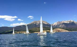 Sailboats make crisscross paths on Lake Dillon with Buffalo Mountain and Red Peak in the background. Many sailors consider Summit County's largest body of water one of the most picturesque reservoirs in the nation.