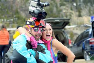 Brett Lomoro, 33, of Breckenridge, poses for a photo with a Gaper Day partier at Arapahoe Basin Ski Area on Wednesday, April 1, 2015.