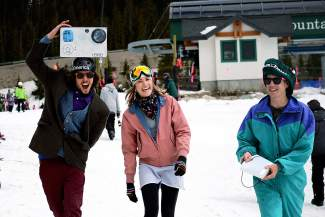 From left to right, Corey Hague, 27, of Breckenridge, Meagan Gliott, 23, of Breckenridge, and Daniel Stange, 26, of Fort Collins, dressed up for Gaper Day at Arapahoe Basin Ski Area on Wednesday, April 1, 2015.