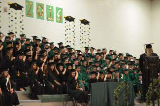Students moved over their tassels in honor of graduation. 164 Summit High School seniors graduated on Saturday.