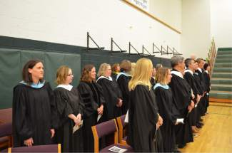 Summit High School teachers stood in recognition of their contributions to students' education.