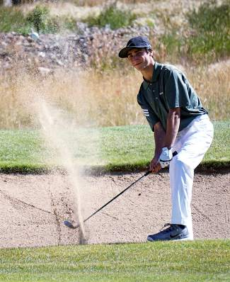 Summit High School's Ethan Moroco hits out of a sand trap during the Keystone Ranch Invitational in 2015. Local golf pros and trainers suggest gym exercises and yoga stretches to improve balance and coordination before the golf season swings into high gear.
