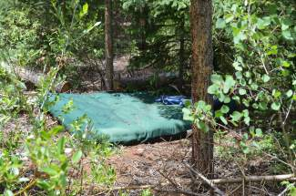 Trash, like this deserted air mattress, is prevalent at previous campsites along Montezuma Road in Keystone following notable long-term and illegal residential stay overs.