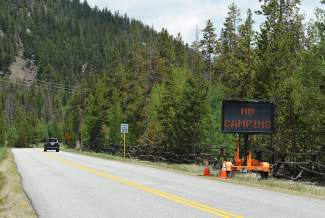 Recently installed digital signage informs motorists and cyclists along County Road 5 in Keystone that overnight camping is prohibited there following the Forest Service's emergency closure of Montezuma Road due to increased bear activity.