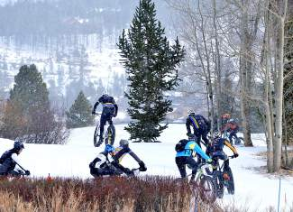 Riders round a bend shortly after the starting gun for the inaugural Fat Bike Open at Gold Run Nordic Center on Dec. 5. The Nordic center is now the only one in Summit County to allow fat bikes on groomed trails.