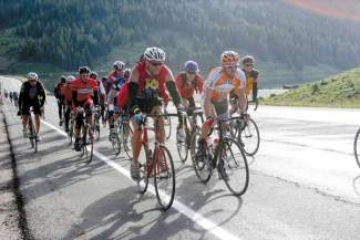 Floyd Landis, at right, climbs Fremont Pass on Highway 91 during the 2012 Copper Triangle ride. The annual event returns to Copper on Aug. 6, with more than 3,000 cyclists expected to make the three-pass ride from Copper to Leadville to Vail and back.