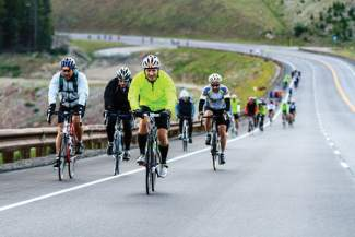 A large pack of cyclist riding in the 2011 Copper Triangle begin the first major climb of the event by heading up Highway 91 to the top of Fremont Pass (11,318 feet). Now in its 11th year, the ride also heads up Tennessee Pass (10,424 feet) and Vail Pass (10,666 feet) to complete a 78-mile loop beginning and ending at Copper Mountain.