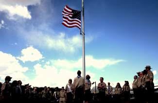 Boy Scouts prepare for a flag retirement ceremony after the Memorial Day ceremony at Dillon Cemetery on Monday, May 30.