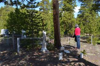 A Summit County resident pays her respects to a gravesite following a Memorial Day ceremony at Valley Brook Cemetery in Breckenridge on Monday, May 30.