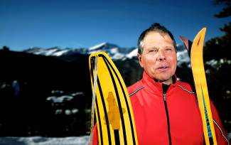 Michigan-turned-Breckenridge local Greg Gutzki with pieces retro ski gear: a 1966 Snurfer, the first snowboard, and a pair of 1980s Miller Soft powder skis, considered one of the first powder-only models.