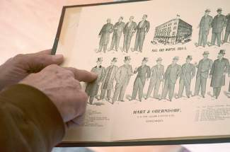 Mike Cavanaugh of the Brown Hotel points to his favorite suit option in a vintage tailor catalogue from Hart and Oberndorf (1894-95), found in the attic during renovations.