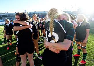 Summit players embrace on the field following their 64-7 win over Chaparral to claim their eighth straight Colorado state rugby championship at Infinity Park in Denver in November. The Tigers recently took second at the High School National Championships, the final high school game for three seniors heading to Division I rugby programs next season.