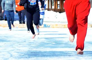 The barefoot sprint across rinks one and two (and back) at the Pabst Blue Ribbon Colorado Pond Hockey Tournament on Feb. 13. The seventh annual tournament, held at North Pond Park in Silverthorne, drew 150 teams and more than 900 players from 45 states for three days of round-robin play and plenty of PBR.