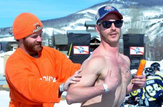 Two players from the Westminster area ward off sunshine and 40-plus degree weather at the Pabst Blue Ribbon Colorado Pond Hockey Tournament on Feb. 13. The seventh annual tournament, held at North Pond Park in Silverthorne, drew 150 teams and more than 900 players from 45 states for three days of round-robin play and plenty of PBR.