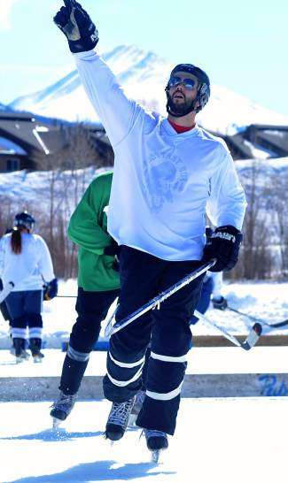 A player in the men's open division celebrates a goal at the Pabst Blue Ribbon Colorado Pond Hockey Tournament on Feb. 13. The seventh annual tournament, held at North Pond Park in Silverthorne, drew 150 teams and more than 900 players from 45 states for three days of round-robin play and plenty of PBR.