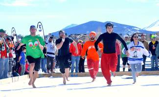 Shoe-less runners take off from the start line during the barefoot sprint at the Pabst Blue Ribbon Colorado Pond Hockey Tournament on Feb. 13. The seventh annual tournament, held at North Pond Park in Silverthorne, drew 150 teams and more than 900 players from 45 states for three days of round-robin play and plenty of PBR.
