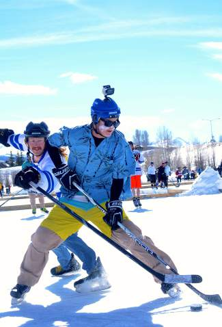 Players vie for the puck (and get GoPro footage for friends back home) at the Pabst Blue Ribbon Colorado Pond Hockey Tournament on Feb. 13. The seventh annual tournament, held at North Pond Park in Silverthorne, drew 150 teams and more than 900 players from 45 states for three days of round-robin play and plenty of PBR.