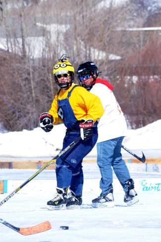 A Minion dressed for ice hockey battles for the puck during the Pabst Blue Ribbon Colorado Pond Hockey Tournament on Feb. 13. The seventh annual tournament, held at North Pond Park in Silverthorne, drew 150 teams and more than 900 players from 45 states for three days of round-robin play and plenty of PBR.