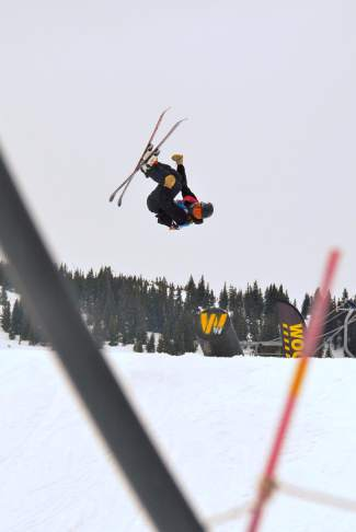 Michale Kennedy of Lakeville, Minnesota gets inverted off the shotgun pipe on the slopestyle course during the youth boy's finals at the 2016 USASA National Championships in Copper on April 12.