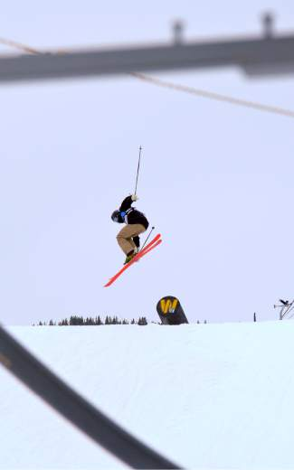 Andre Kemink of Sandpoint, Idaho spins off the shotgun tube during the youth boy's slopestyle finals at the 2016 USASA National Championships in Copper on April 12.