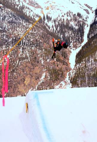 Jack Murphy of Fairfield, Connecticut hucks off the first jump of the slopestyle course during the youth boy's finals at the 2016 USASA National Championships for skiing in Copper on April 12.