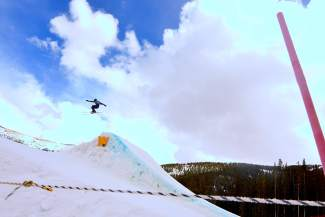 A skier airs over the first jump in the Copper slopestyle course during the youth boy's finals at the 2016 USASA National Championships for skiing on April 12. Nationals drew nearly 300 skiers from across the nation and globe for four days of competition in slopestyle, halfpipe, skiercross and rail jam.