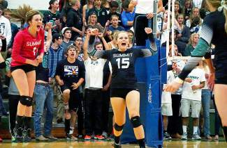 Summit's Autumn Ward (15) and Sage Kent (1) celebrate after scoring a point during their homecoming match against Steamboat Springs on Oct. 1. The Tigers would go on to lose the match 1-3 in four tight sets.
