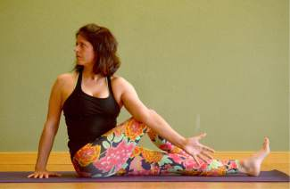 Seated twist yoga pose for kayakers and rafters.