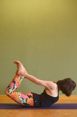 Bow yoga pose for kayakers and rafters.