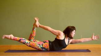 Modified Locust pose for kayakers and rafters.
