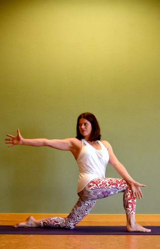 Crescent Moon with a twist yoga posture for golfers.