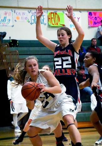 Summit's Cassidy Bargell, left, looks to pass the ball with Eagle Valley's Regan Bossow defending during a home game in early January. The girl's team has struggled with shooting percentage, but they're quick with rebounds and strong on the outside of the arc.