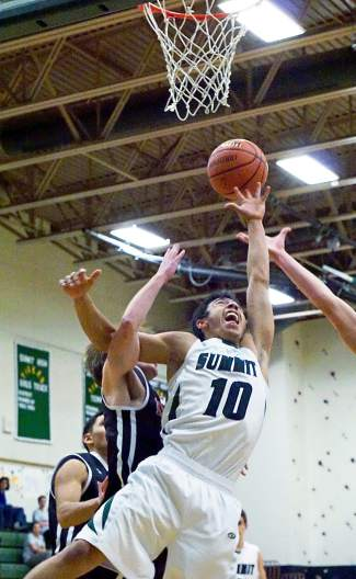 Summit's Jesus Moya (10) goes after a rebound during the first half of the Tigers' 48-42 win over Eagle Valley at home on Jan. 8. It was the first win of the season for the boy's basketball team.