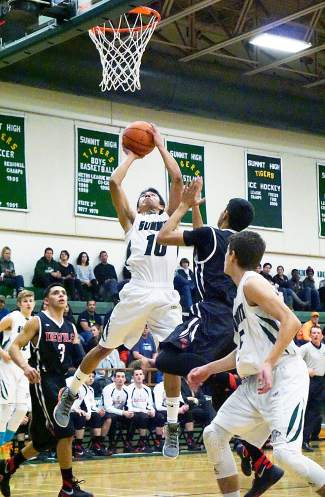 Summit's Jesus Moya (10) takes a shot during the Tigers' 48-42 win over Eagle Valley at home on Jan. 8. Moya came through in several clutch situations, including a momentum-shifting set of points near the end of the first half.