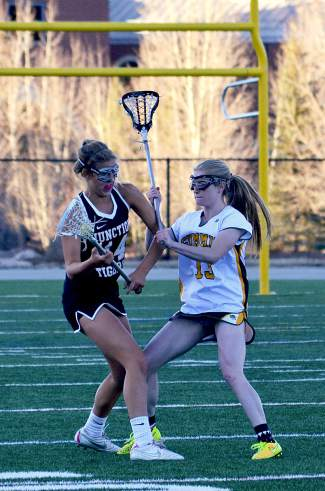 Summit attacker Kenady Nevicosi tries to rattle a Grand Junction player during the second half of a girl's varsity lacrosse game at home on May 3. Nevicosi lead the home team with four goals en route to a 7-10 loss.