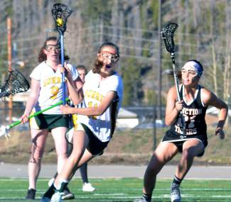 Summit junior Lillian Walker weaves through Grand Junction players during the first half of a girl's varsity lacrosse game at home on May 3. The Tigers lost, 7-10.
